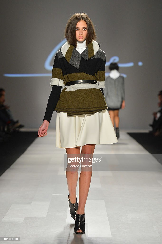 A model walks the runway wearing Line Knitwear fall 2013 collection during World MasterCard Fashion Week Fall 2013 at David Pecaut Square on March 19, 2013 in Toronto, Canada.