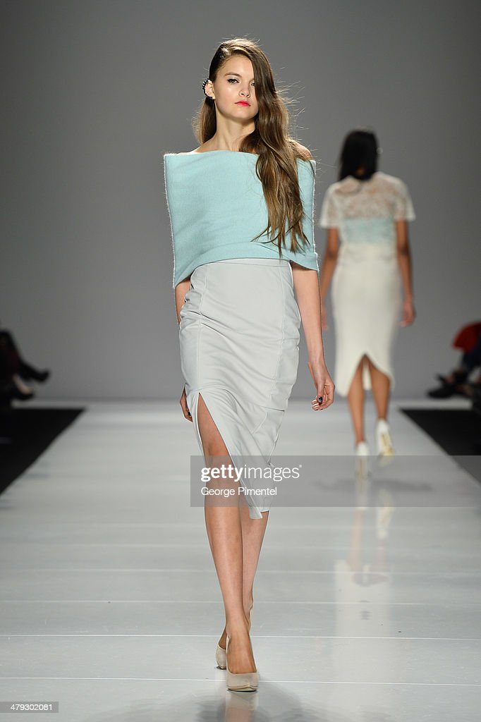 A model walks the runway wearing Line Knitwear fall 2014 collection during World MasterCard Fashion Week Fall 2014 at David Pecaut Square on March 17, 2014 in Toronto, Canada.