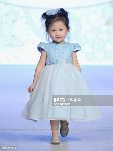 A model walks the runway wearing Little Emerald at Vancouver Fashion Week Fall/Winter 2017 at Chinese Cultural Centre of Greater Vancouver on March...