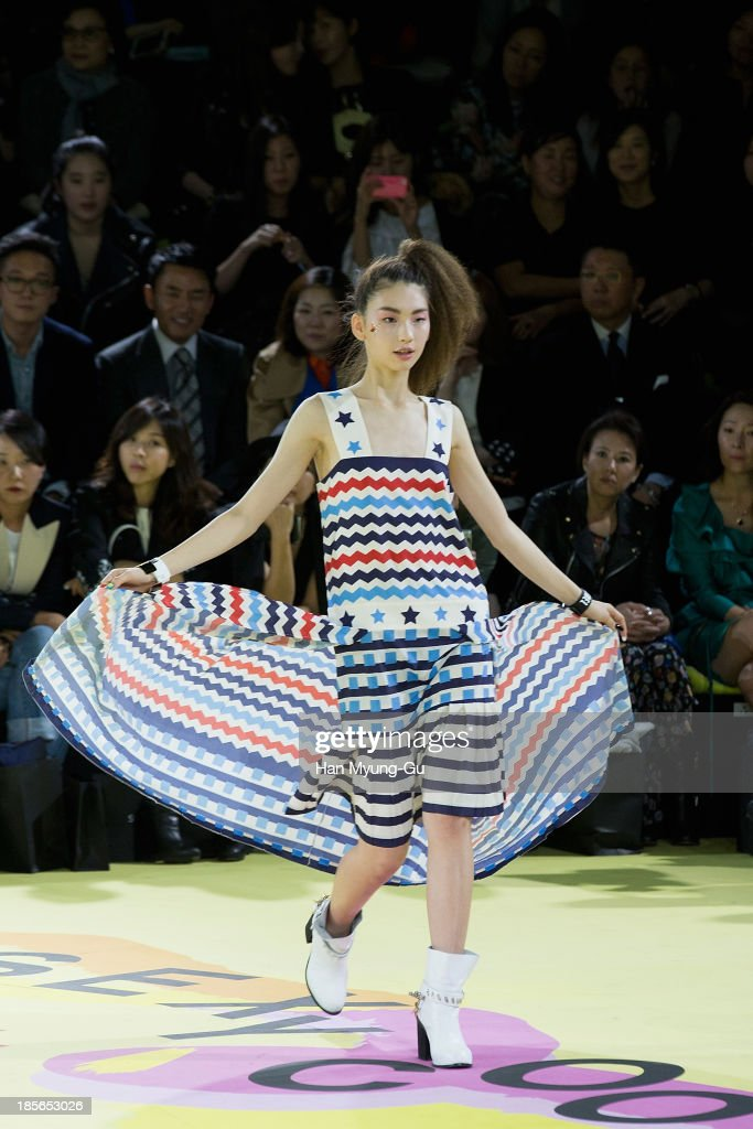 A model walks the runway wearing 'Lucky Chouette' 2014 S/S collection during Seoul Fashion Week Spring/Summer 2014 at the Grand Hyatt Hotel on October 22, 2013 in Seoul, South Korea.