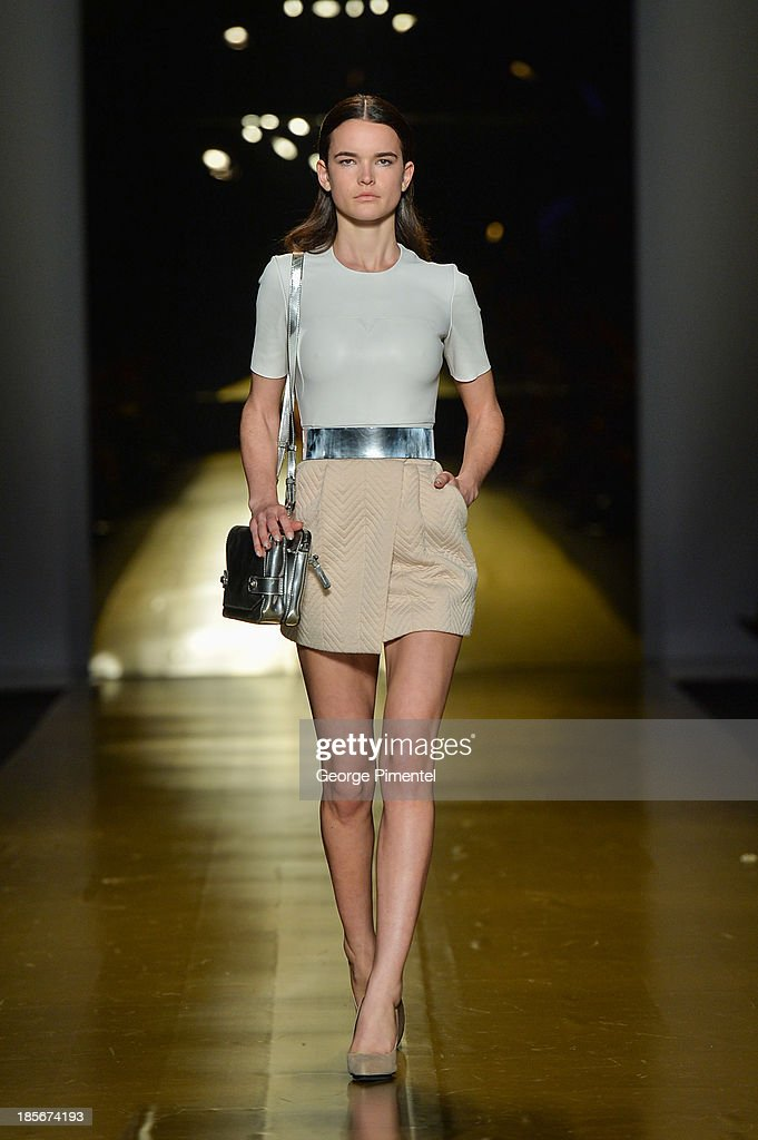 A model walks the runway wearing Mackagespring 2014 collection during World MasterCard Fashion Week Spring 2014 at David Pecaut Square on October 23, 2013 in Toronto, Canada.