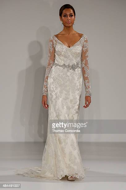 A model walks the runway wearing Maggie Sottero Spring 2015 Bridal collection at the The Hilton Hotel on April 12 2014 in New York City