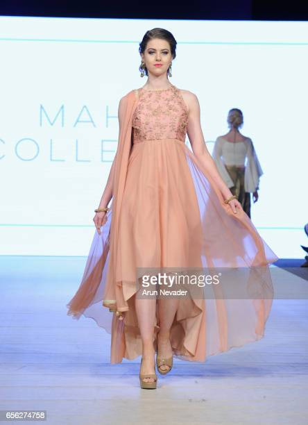 A model walks the runway wearing Mahari Collection at Vancouver Fashion Week Fall/Winter 2017 at Chinese Cultural Centre of Greater Vancouver on...