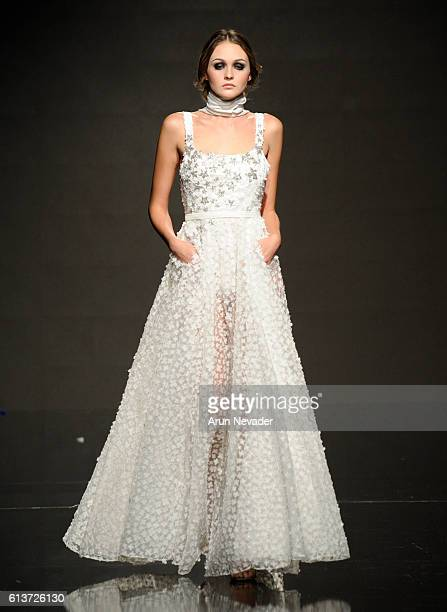 A model walks the runway wearing Marmar Halim at Art Hearts Fashion Los Angeles Fashion Week presented by AIDS Healthcare Foundation on October 9...