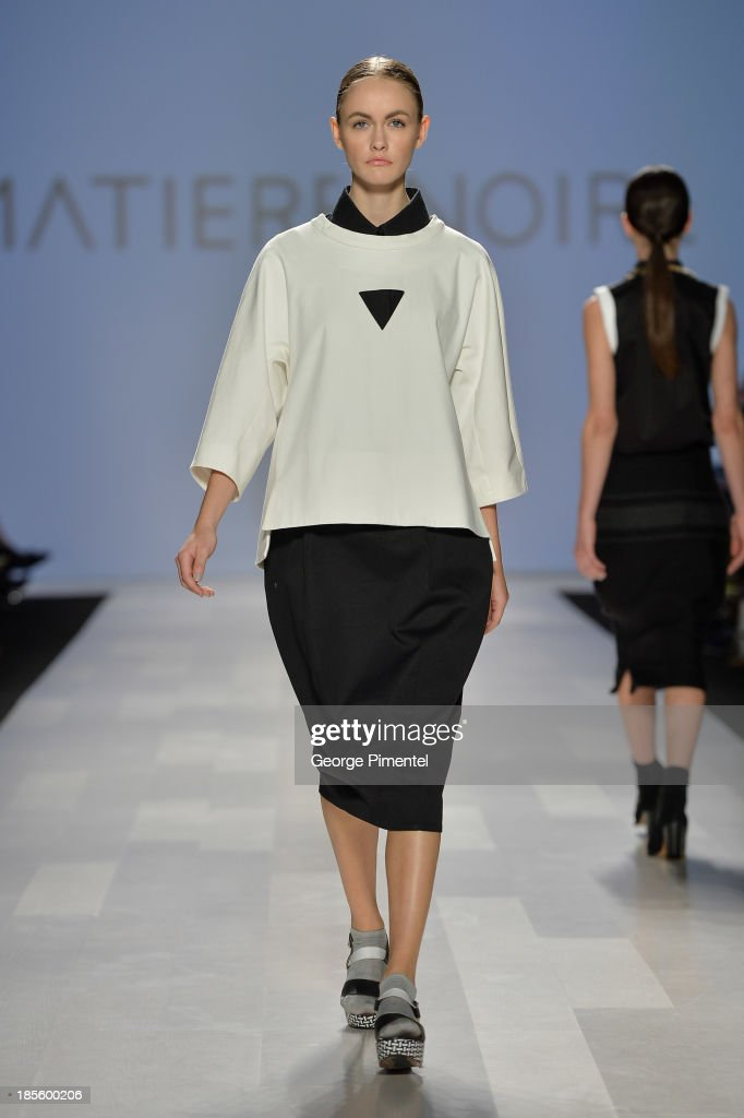 A model walks the runway wearing Matiere Noire spring 2014 collection during the Mercedes-Benz Start-Up national final at World MasterCard Fashion Week Spring 2014 at David Pecaut Squareat David Pecaut Square on October 22, 2013 in Toronto, Canada.