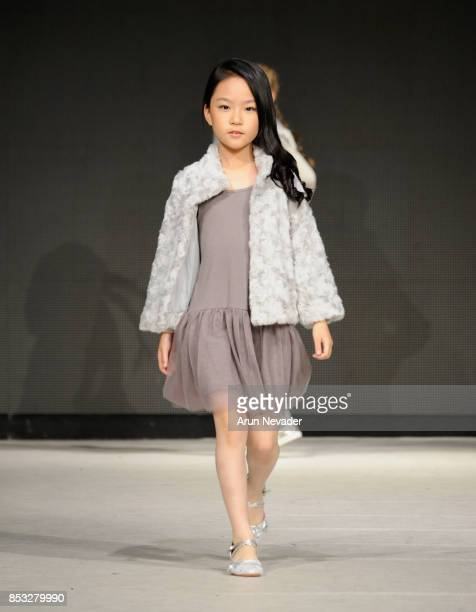 A model walks the runway wearing Mayoral Presented by VSI at 2017 Vancouver Fashion Week Day 7 on September 24 2017 in Vancouver Canada