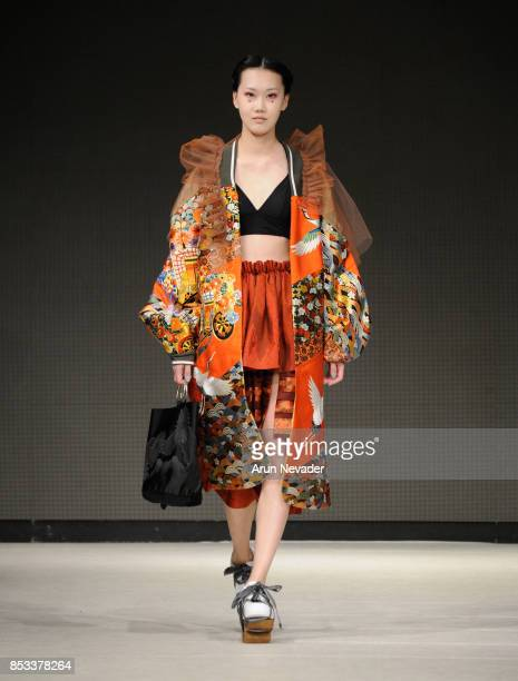 A model walks the runway wearing Minori Isomichi at 2017 Vancouver Fashion Week Day 7 on September 24 2017 in Vancouver Canada