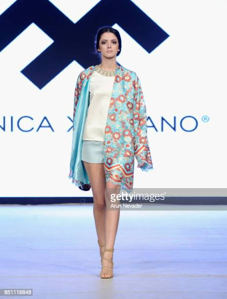 A model walks the runway wearing Monica Xerrano at 2017 Vancouver Fashion Week Day 4 on September 21 2017 in Vancouver Canada