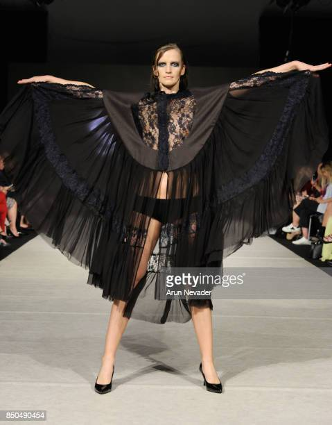 A model walks the runway wearing Mouton Blanc at 2017 Vancouver Fashion Week Day 3 on September 20 2017 in Vancouver Canada