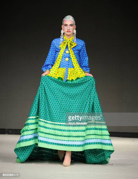 A model walks the runway wearing MRHUA MRSHUA at 2017 Vancouver Fashion Week Day 7 on September 24 2017 in Vancouver Canada
