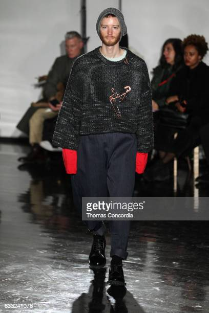 A model walks the runway wearing N Hoolywood during NYFW Men's on January 31 2017 in New York City