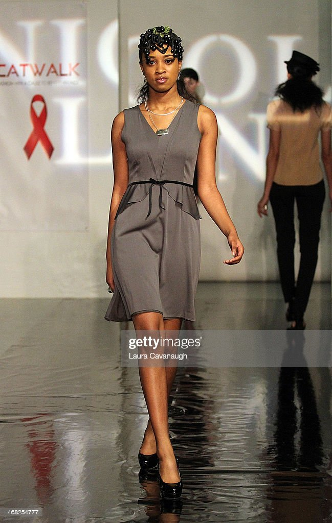 Model walks the runway wearing Nicole Lenzen design at the Hairshion fashion show during Mercedes-Benz Fashion Week Fall 2014 at Alvin Alley Studios on February 9, 2014 in New York City.