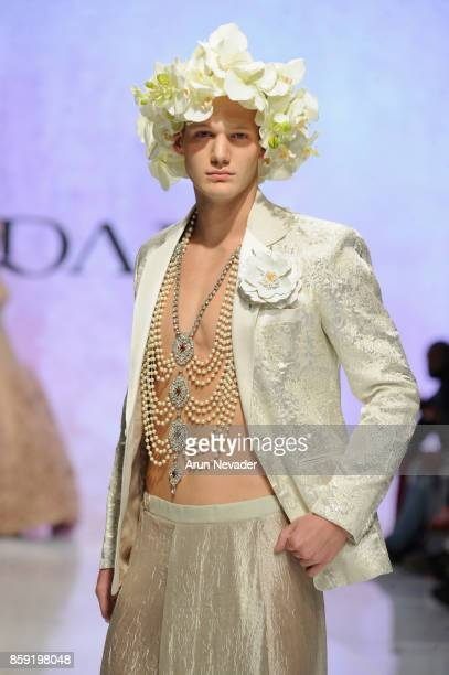 A model walks the runway wearing Nidal Nouaihed at Los Angeles Fashion Week SS18 Art Hearts Fashion LAFW on October 8 2017 in Los Angeles California