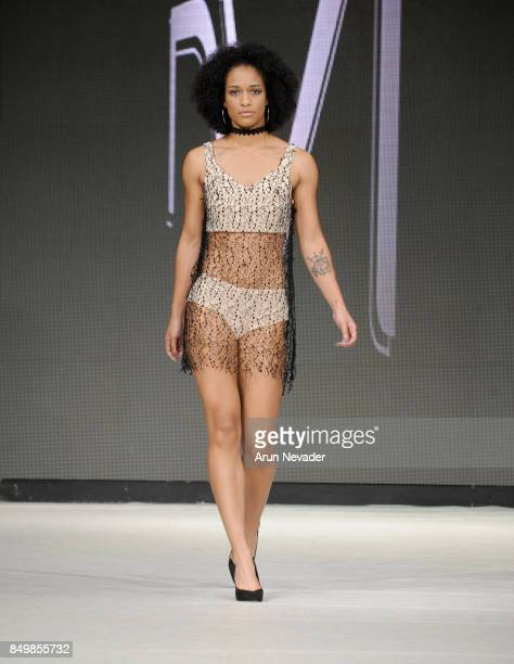 A model walks the runway wearing NVI at the 2017 Vancouver Fashion Week Day 2 on September 19 2017 in Vancouver Canada