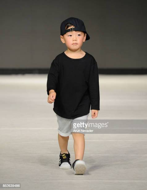 A model walks the runway wearing Os Oakes at 2017 Vancouver Fashion Week Day 6 on September 23 2017 in Vancouver Canada