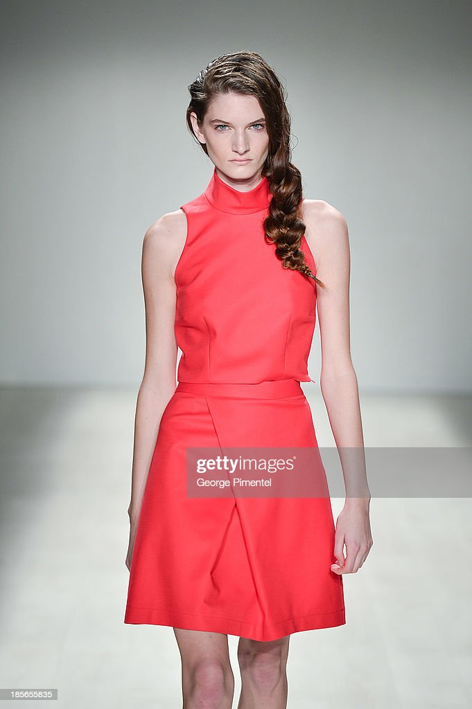 A model walks the runway wearing Paria Shirvani spring 2014 collection during World MasterCard Fashion Week Spring 2014 at David Pecaut Square on October 23, 2013 in Toronto, Canada.