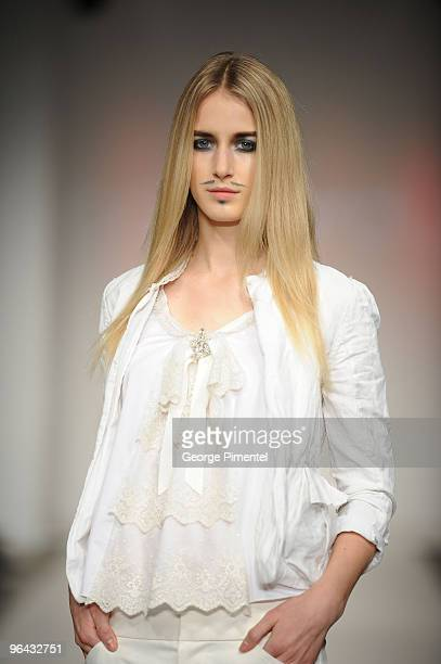 A model walks the runway wearing Paul Hardy's 2010 Spring Collection at 1030 King St W on October 21 2009 in Toronto Canada