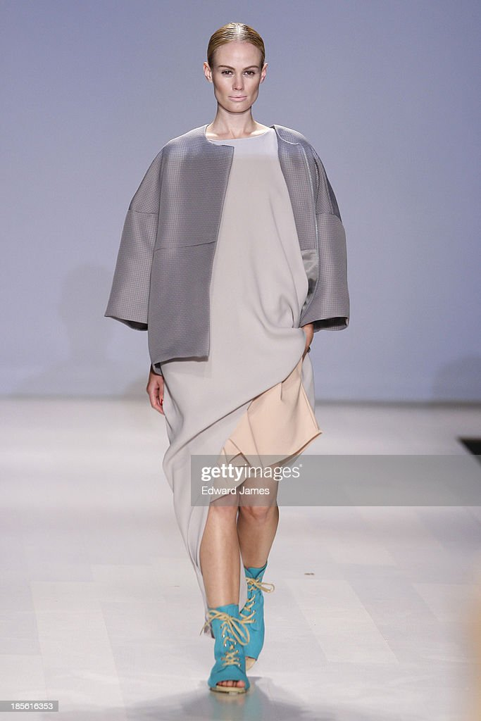 A model walks the runway wearing Pedram Karimi during the Mercedes-Benz Startup Finals fashion show at David Pecaut Square on October 22, 2013 in Toronto, Canada.