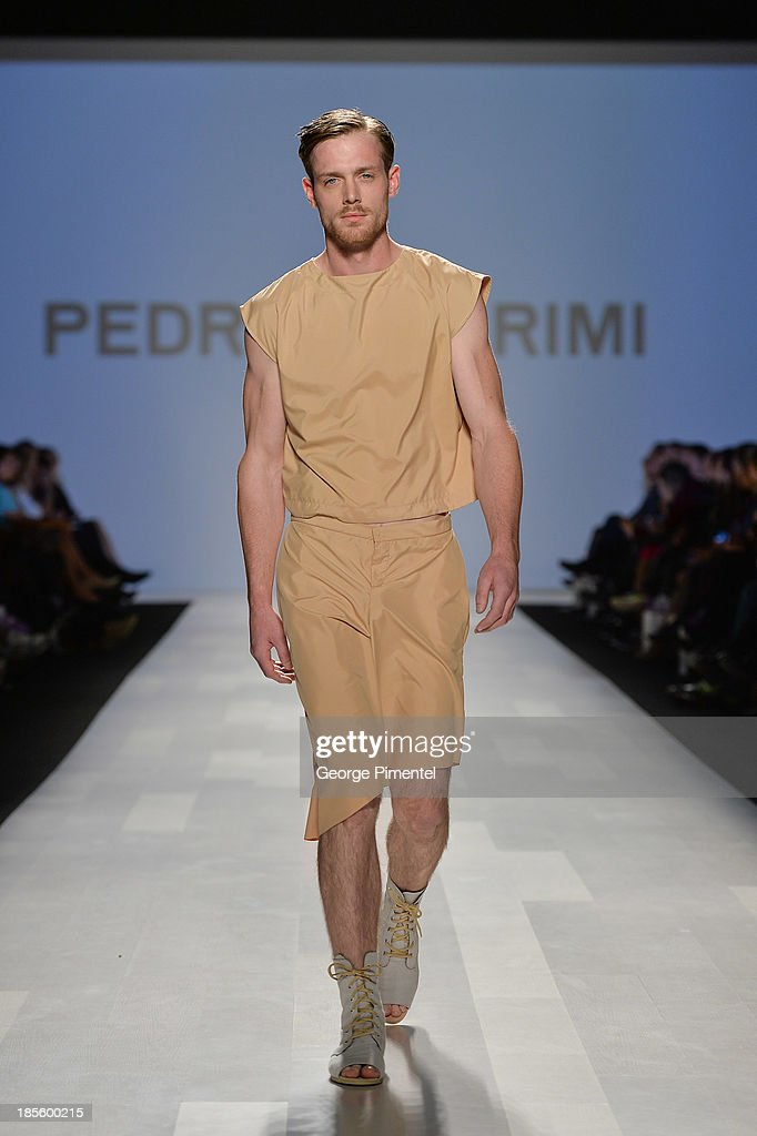 A model walks the runway wearing Pedram Karimi spring 2014 collection during the Mercedes-Benz Start-Up national final at World MasterCard Fashion Week Spring 2014 at David Pecaut Squareat David Pecaut Square on October 22, 2013 in Toronto, Canada.