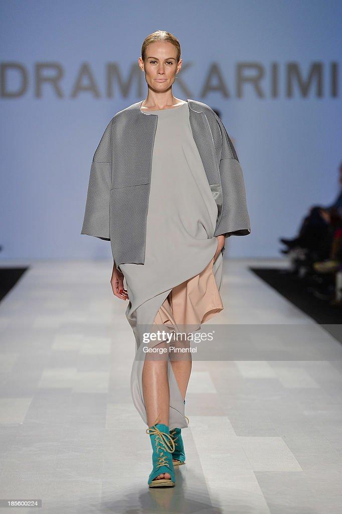 A model walks the runway wearing Pedram Karimi spring 2014 collection during the Mercedes-Benz Start-Up national final at World MasterCard Fashion Week Spring 2014 at David Pecaut Squareat David Pecaut Square on October 22, 2013 in Toronto, Canada.