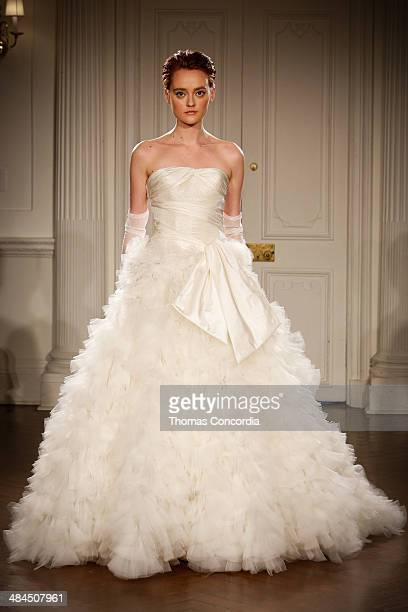 A model walks the runway wearing Peter Langner Spring 2015 Bridal collection at Academy Mansion on April 12 2014 in New York City