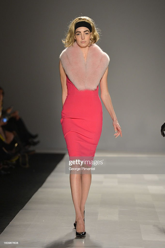 A model walks the runway wearing Pink Tartan fall 2013 collection at David Pecaut Square on March 18, 2013 in Toronto, Canada.