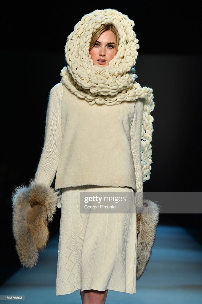 A model walks the runway wearing Pink Tartan fall 2014 collection during World MasterCard Fashion Week Fall 2014 at David Pecaut Square on March 19, 2014 in Toronto, Canada.