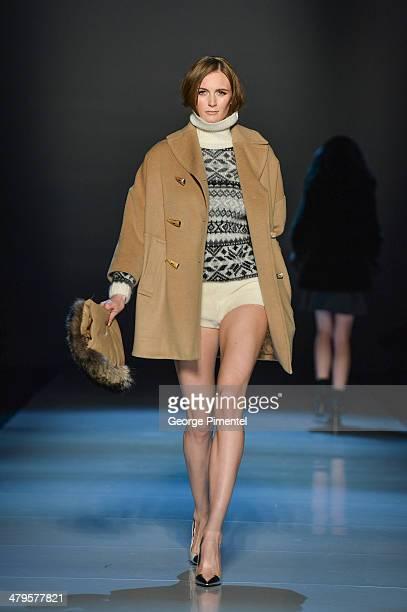 A model walks the runway wearing Pink Tartan fall 2014 collection during World MasterCard Fashion Week Fall 2014 at David Pecaut Square on March 19...