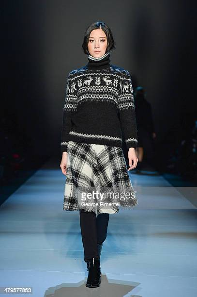 A model walks the runway wearing Pink Tartan fall 2014 collection during World MasterCard Fashion Week Fall 2014 at David Pecaut Square on March 19...