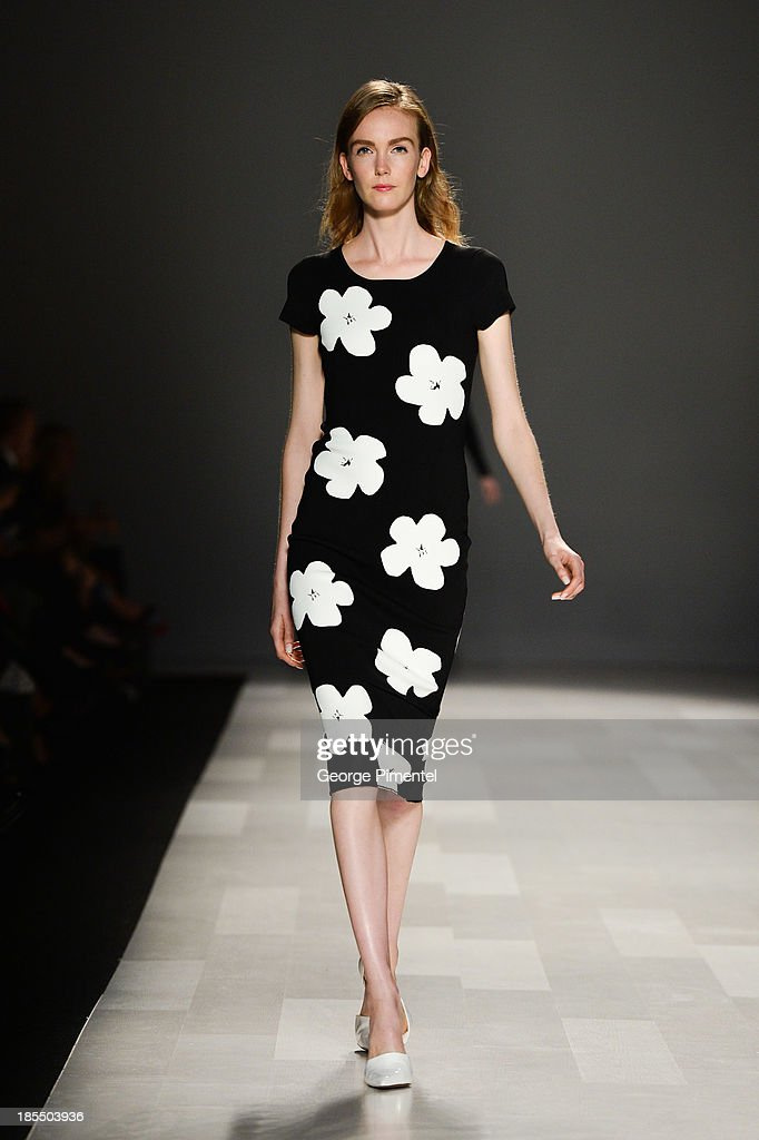 A model walks the runway wearing Pink Tartan spring 2014 collection during World MasterCard Fashion Week Spring 2014 at David Pecaut Square on October 21, 2013 in Toronto, Canada.