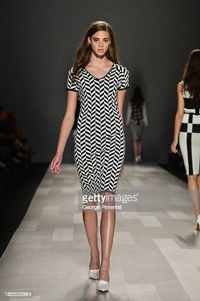A model walks the runway wearing Pink Tartan spring 2014 collection during World MasterCard Fashion Week Spring 2014 at David Pecaut Square on...
