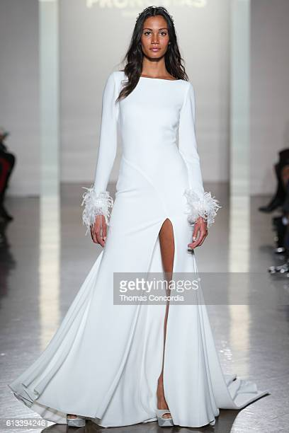 A model walks the runway wearing Pronovias Bridal at Prince George Ballroom on October 8 2016 in New York City