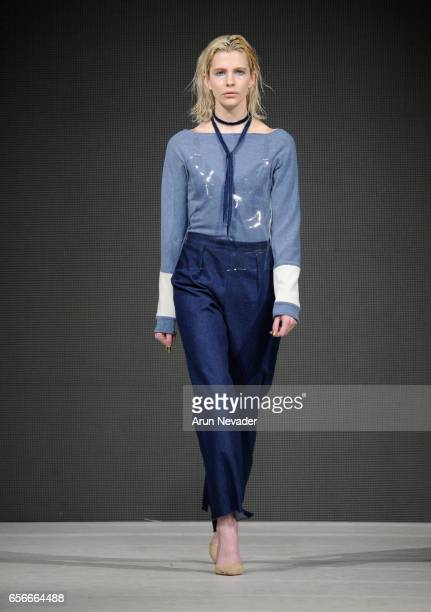 A model walks the runway wearing Rachelle Anne Wear at Vancouver Fashion Week Fall/Winter 2017 at Chinese Cultural Centre of Greater Vancouver on...