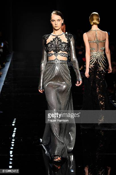 A model walks the runway wearing Reem Acra Fall 2016 during New York Fashion Week The Shows at The Dock Skylight at Moynihan Station on February 15...