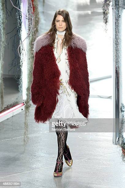 A model walks the runway wearing Rodarte S/S 2016 and Kerastase Paris during New York Fashion Week at Center 548 on September 15 2015 in New York City