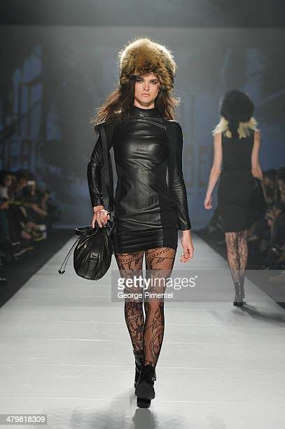 A model walks the runway wearing Rudsak fall 2014 collection during World MasterCard Fashion Week Fall 2014 at David Pecaut Square on March 20 2014...