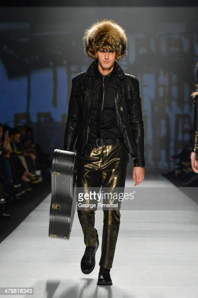 A model walks the runway wearing Rudsak fall 2014 collection during World MasterCard Fashion Week Fall 2014 at David Pecaut Square on March 20 2014...