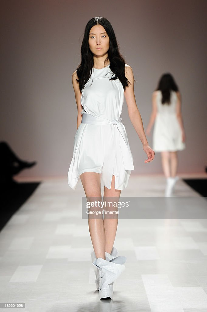 A model walks the runway wearing Sid Neigum spring 2014 collection during World MasterCard Fashion Week Spring 2014 at David Pecaut Square at David Pecaut Square on October 22, 2013 in Toronto, Canada.