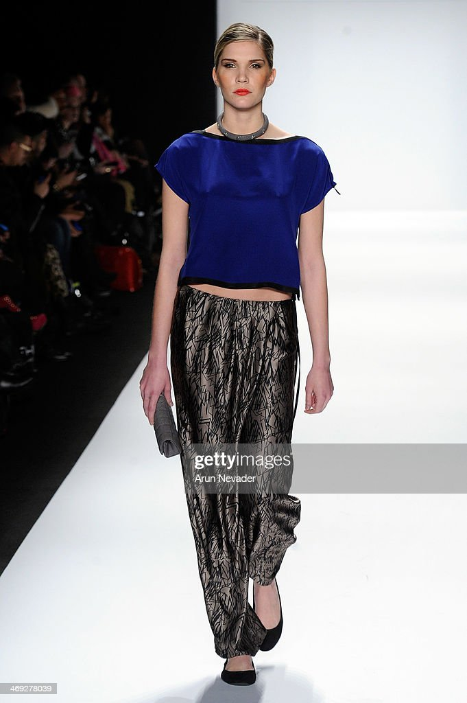 A model walks the runway wearing Silk Skin at the FLT Moda + Art Hearts Fashion show presented by AIDS Healthcare Foundation during Mercedes-Benz Fashion Week Fall 2014 at The Theatre at Lincoln Center on February 13, 2014 in New York City.