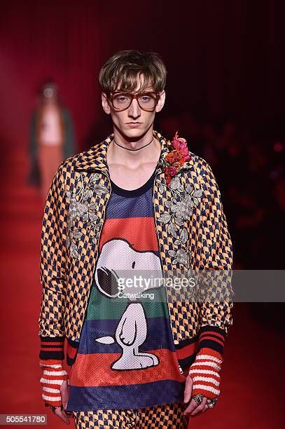 A model walks the runway wearing Snoopy dog cartoon detail at the Gucci Autumn Winter 2016 fashion show during Milan Menswear Fashion Week on January...