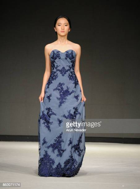 A model walks the runway wearing Srishti Kaur Designs at 2017 Vancouver Fashion Week Day 5 on September 22 2017 in Vancouver Canada