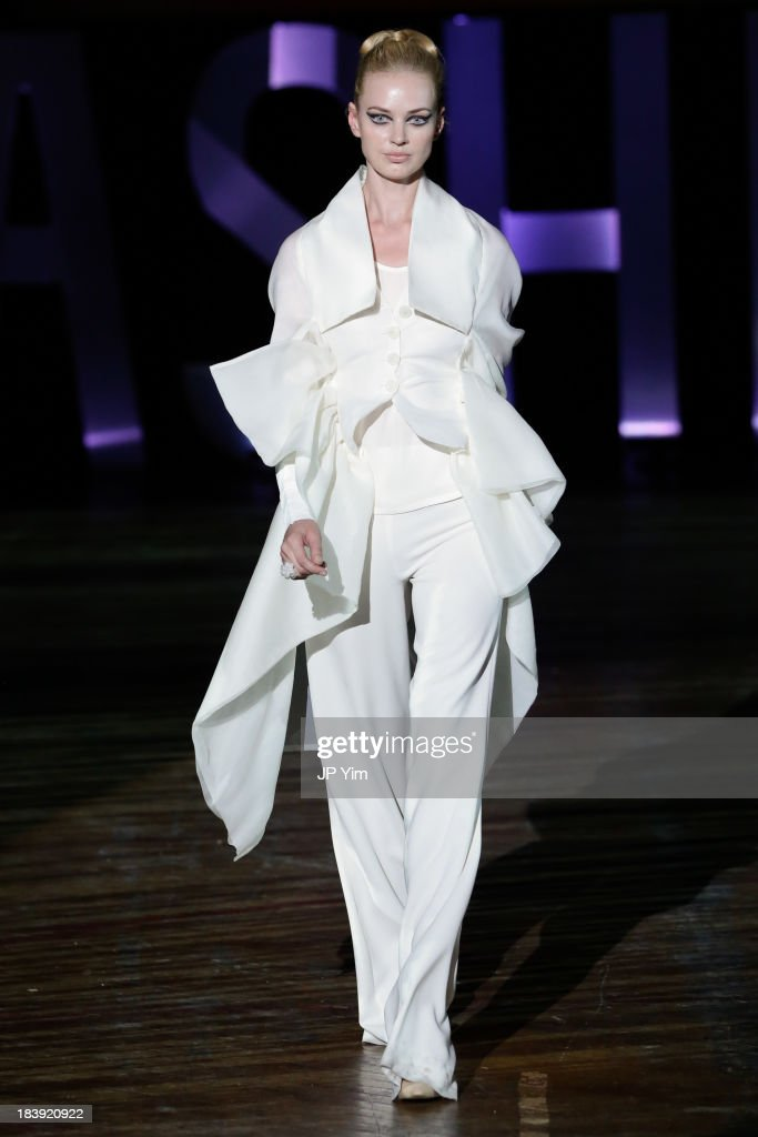 A model walks the runway wearing Sukeina during the 3rd Annual United Colors Of Fashion Gala at Lexington Avenue Armory on October 9, 2013 in New York City.
