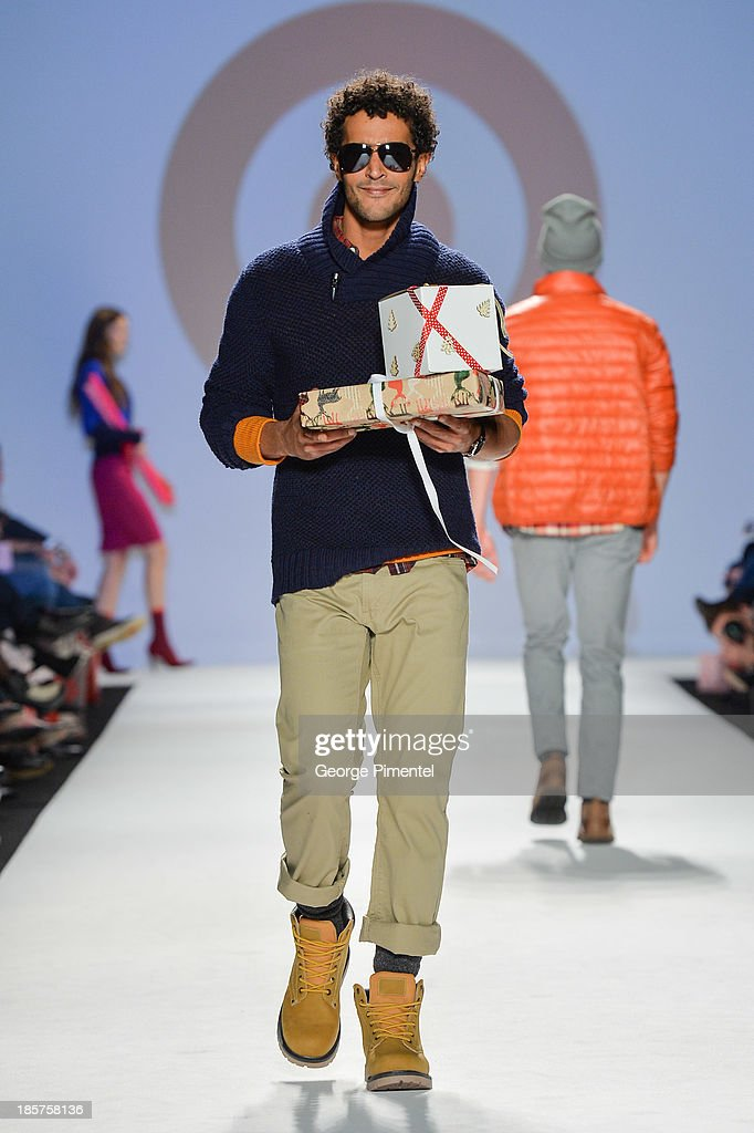 A model walks the runway wearing Target spring 2014 collection during World MasterCard Fashion Week Spring 2014 at David Pecaut Square on October 24, 2013 in Toronto, Canada.