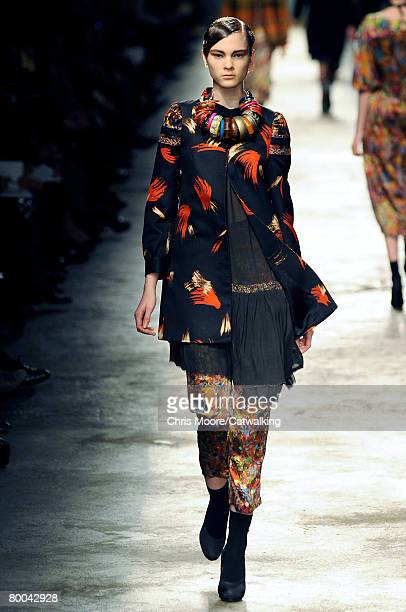 A model walks the runway wearing the Dries Van Noten Fall/Winter 2008/2009 collection during Paris Fashion Week on the 26th of February 2008 in...