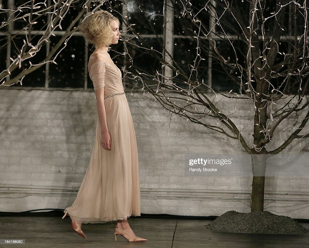 A model walks the runway wearing the first look during the Jenny Packham Fall 2014 Bridal collection show & 25th anniversary reception on October 11, 2013 in New York City.