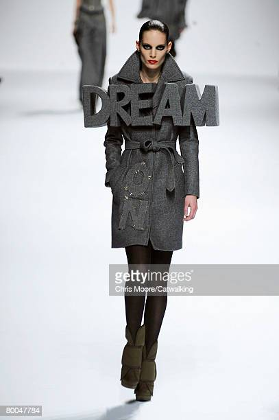 A model walks the runway wearing the Viktor Rolf Fall/Winter 2008/2009 collection during Paris Fashion Week February 27 2008 in Paris France