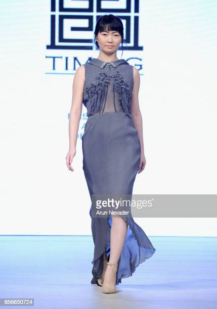 A model walks the runway wearing TimaG at Vancouver Fashion Week Fall/Winter 2017 at Chinese Cultural Centre of Greater Vancouver on March 22 2017 in...