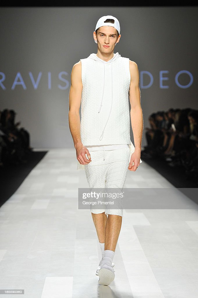 A model walks the runway wearing Travis Taddeo spring 2014 collection during World MasterCard Fashion Week Spring 2014 at David Pecaut Squareat David Pecaut Square on October 22, 2013 in Toronto, Canada.
