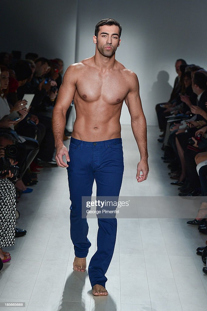 A model walks the runway wearing Triarchy Êspring 2014 collection during World MasterCard Fashion Week Spring 2014 at David Pecaut Square on October 23, 2013 in Toronto, Canada.