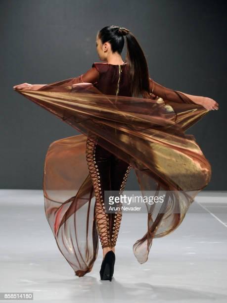 A model walks the runway wearing Usama Ishtay At Los Angeles Fashion Week SS18 Art Hearts Fashion LAFW on October 6 2017 in Los Angeles California